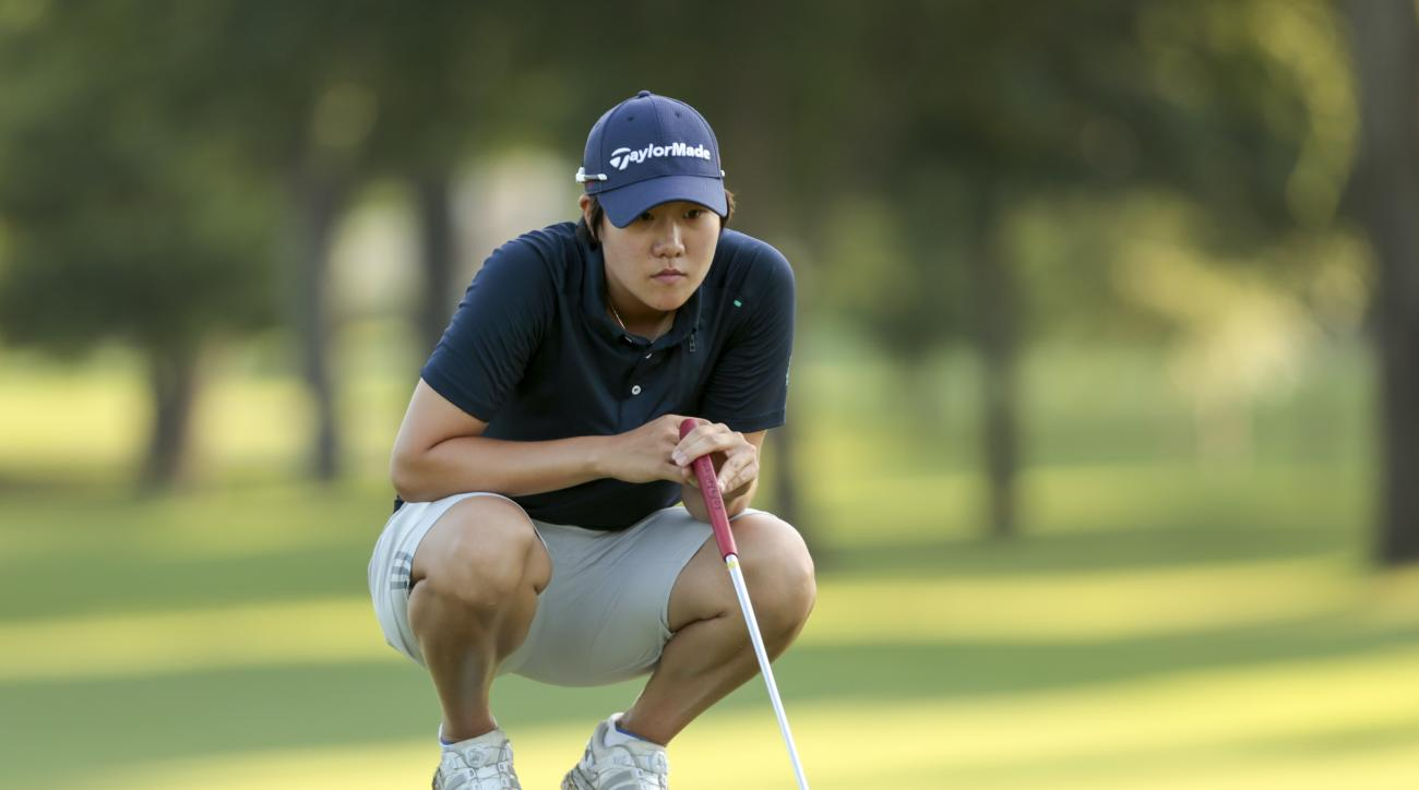 Eun-Jeong Seong lines up her putt on the fifth hole during the quarterfinal round of match play of the U.S. Girls' Junior golf tournament at Tulsa Country Club in Tulsa, Okla., on Friday, July 24, 2015. (Steven Gibbons/USGA via AP)