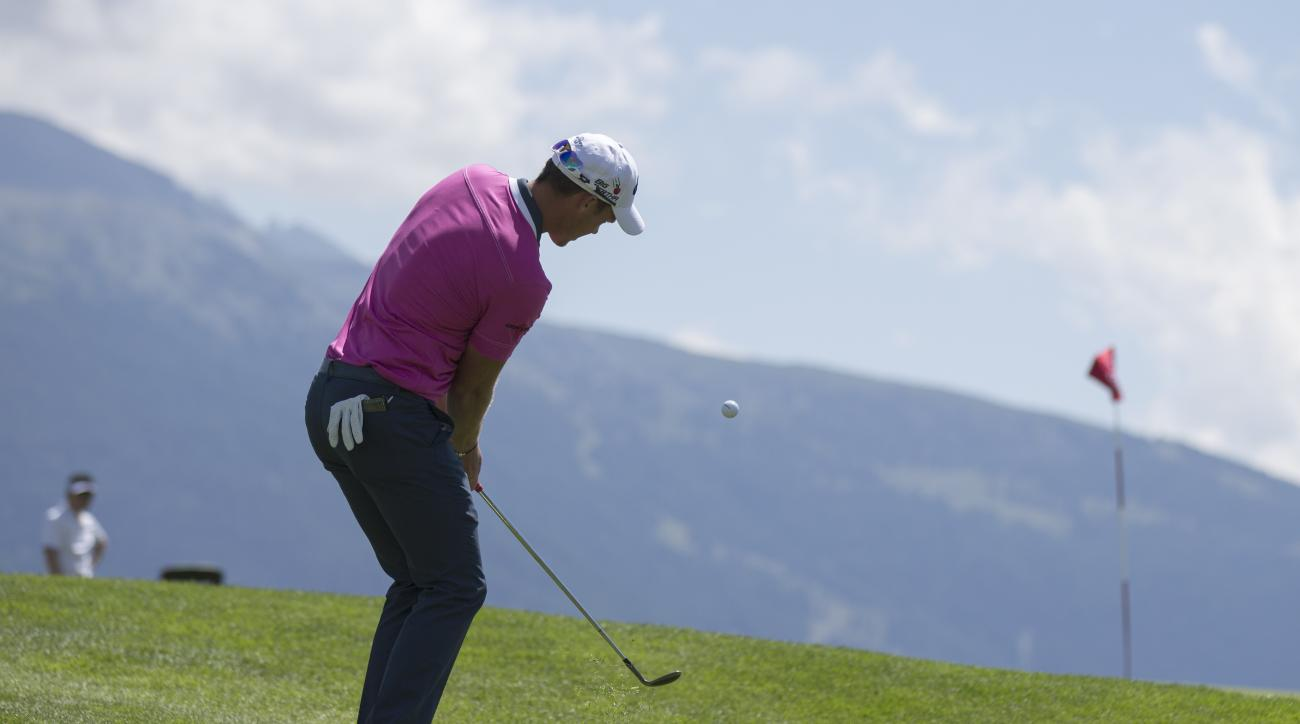 Danny Willett of England plays a ball at the 7th hole during the third round of the Omega European Masters golf tournament in Crans-Montana, Switzerland, Saturday, July 25, 2015. (Peter Klaunzer/Keystone via AP)