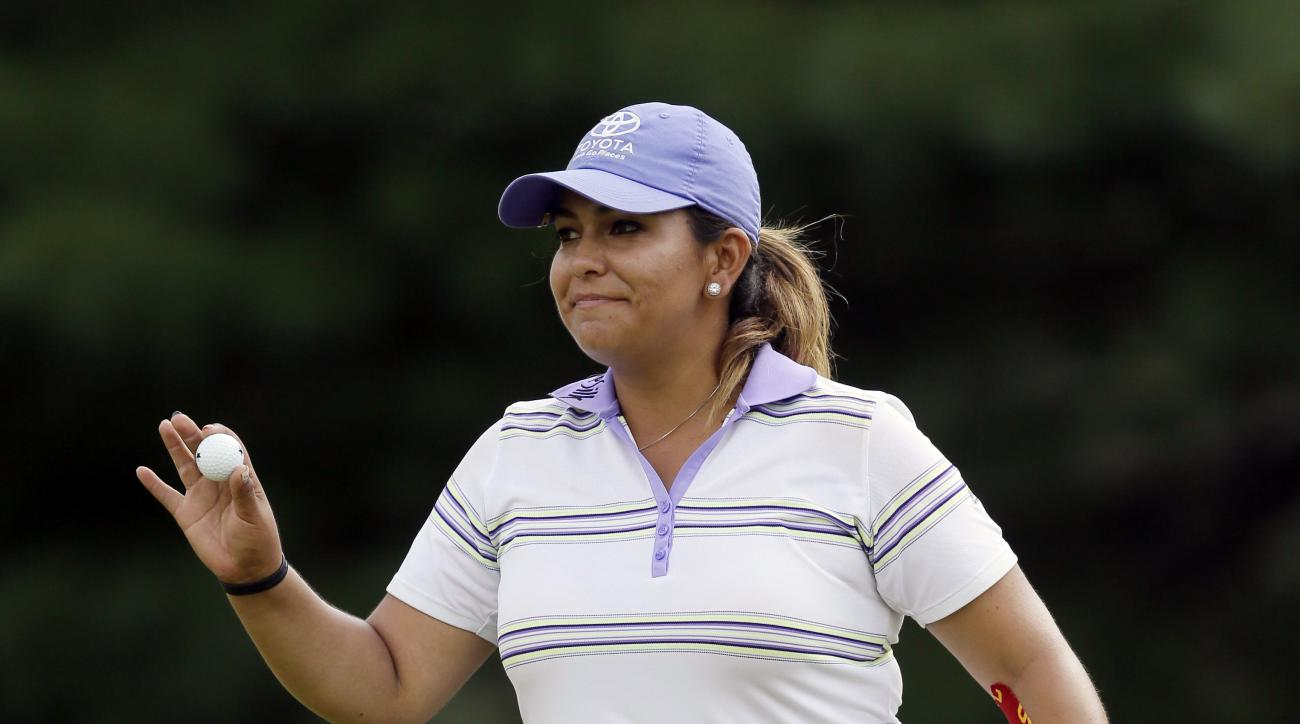 Lizette Salas acknowledges the crowd on the 15th green during the third round of the Meijer LPGA Classic golf tournament Saturday, July 25, 2015 in Belmont, Mich. (AP Photo/Carlos Osorio)