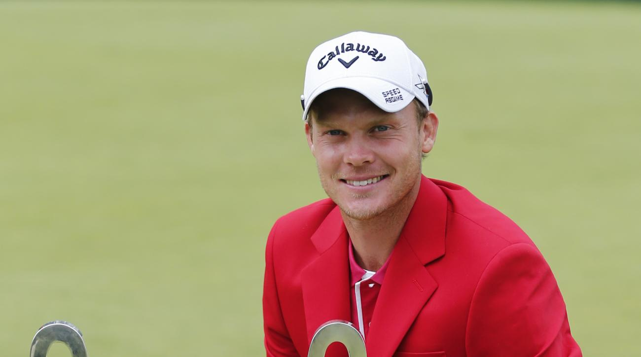 Winner Danny Willett of England poses with the trophy after the final round of the Omega European Masters golf tournament in Crans-Montana, Switzerland, Sunday, July 26, 2015. (Peter Klaunzer/Keystone via AP)