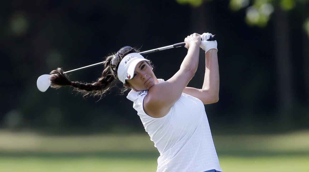 Gerina Piller hits from the fairway on the first hole during the final round of the Meijer LPGA Classic golf tournament Sunday, July 26, 2015, in Belmont, Mich. (AP Photo/Carlos Osorio)