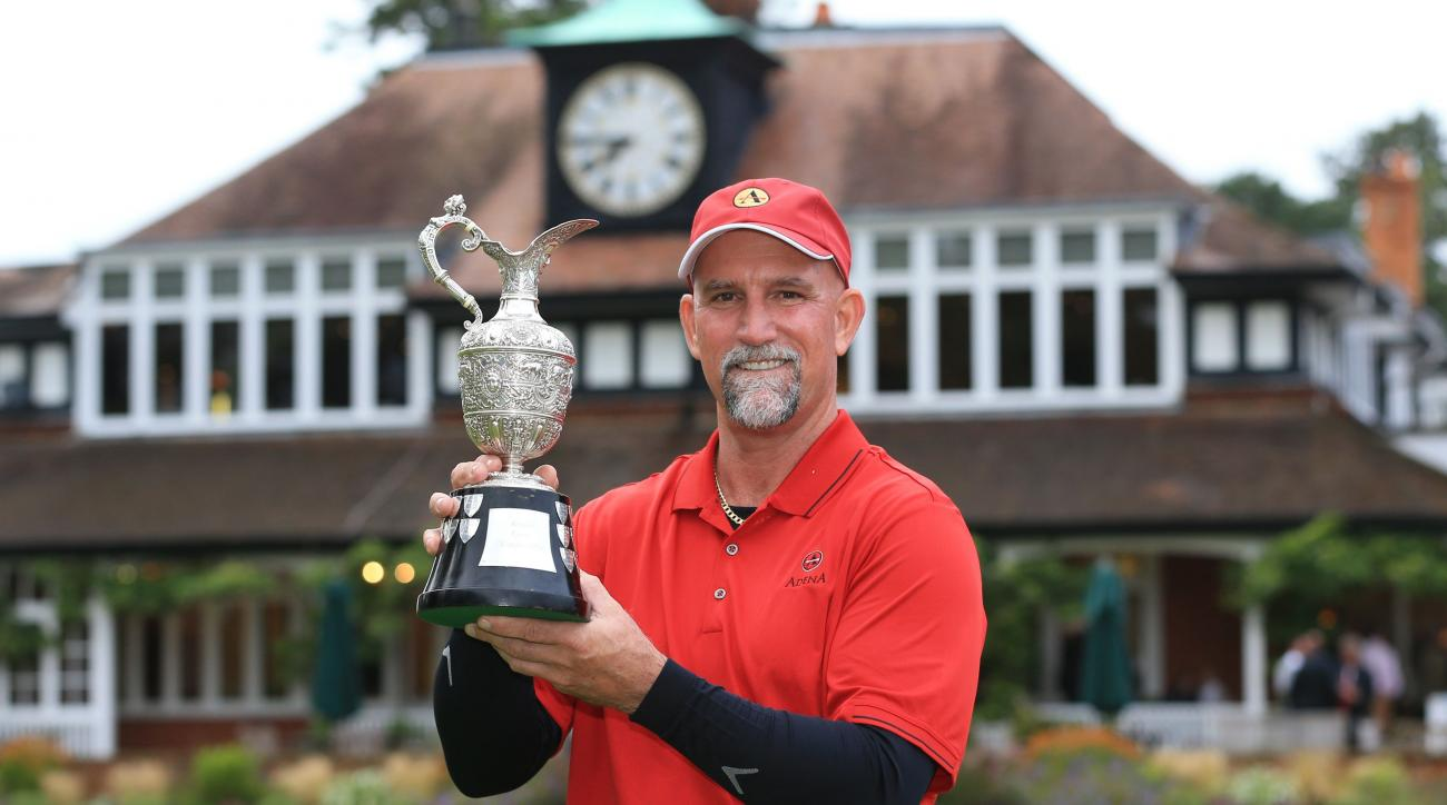 USA's Marco Dawson Senior celebrates winning the 2015 Senior Open Golf Championship at Sunningdale Golf Club,  England, Sunday, July 26, 2015.  (Nigel French/PA via AP)     UNITED KINGDOM OUT  NO SALES NO ARCHIVES