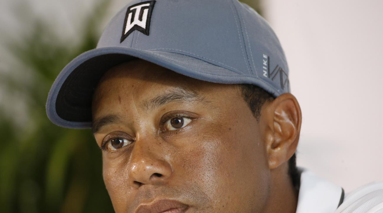 Tiger Woods listens to a question during a news conference prior to the start of the Quicken Loans National golf tournament at the Robert Trent Jones Golf Club in Gainesville, Va., Tuesday, July 28, 2015.  (AP Photo/Steve Helber)