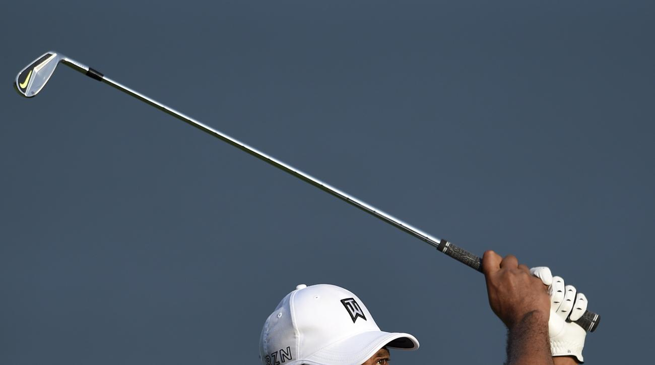 Tiger Woods watches his shot on the 17th fairway during the first round of the Quicken Loans National golf tournament at the Robert Trent Jones Golf Club in Gainesville, Va., Thursday, July 30, 2015. (AP Photo/Nick Wass)