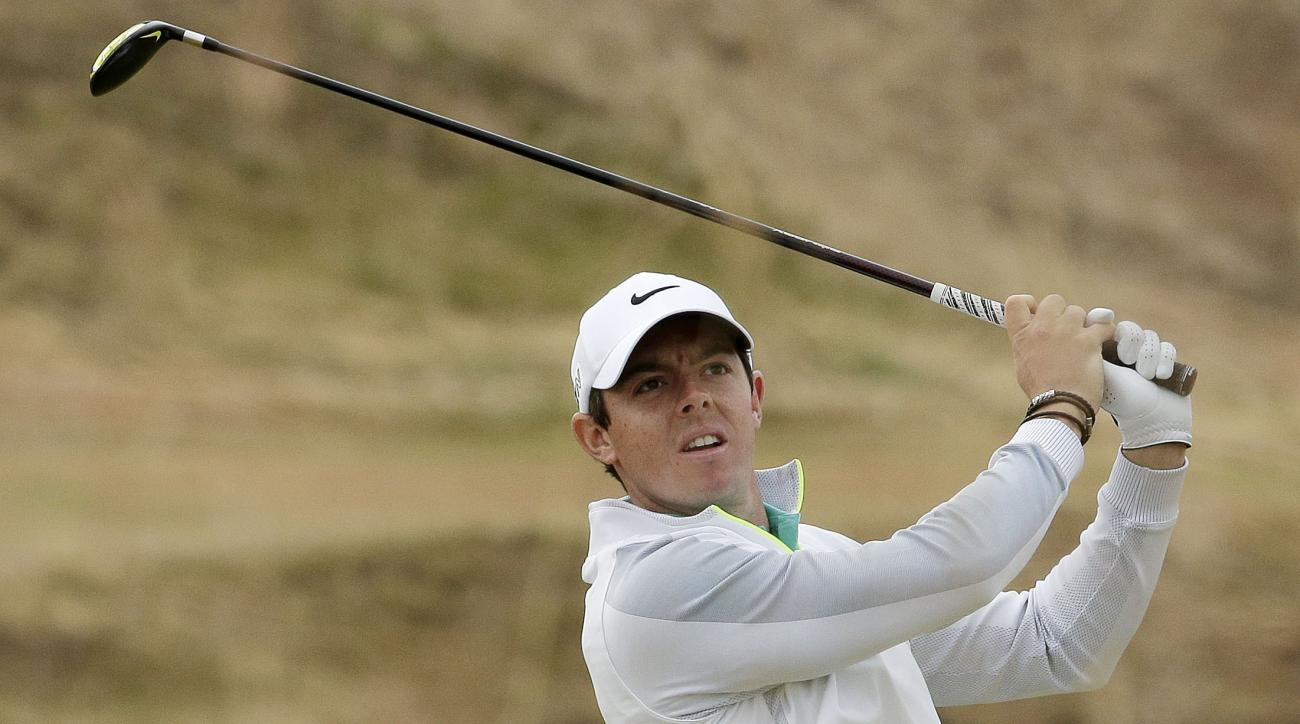 FILE - In this Thursday, June 18, 2015 file photo, Rory McIlroy, of Northern Ireland, watches his tee shot on the 10th hole during the first round of the U.S. Open golf tournament at Chambers Bay in University Place, Wash.  Rory McIlroy posted two videos