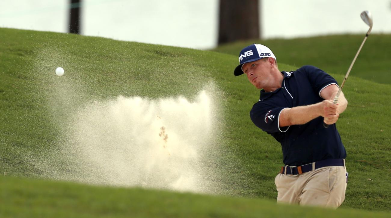 Martin Piller hits out of the sand bunker on the 18th hole during the third round of the Barbasol Championship golf tournament, Saturday, July 18, 2015, in Opelika, Ala. (AP Photo/Butch Dill)
