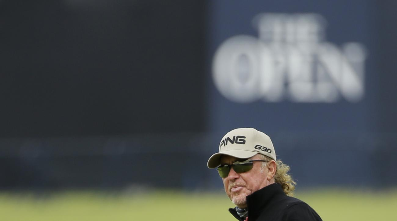 Spain's Miguel Angel Jimenez reacts to his putt on the 17th green during the first round of the British Open Golf Championship at the Old Course, St. Andrews, Scotland, Thursday, July 16, 2015. (AP Photo/David J. Phillip)
