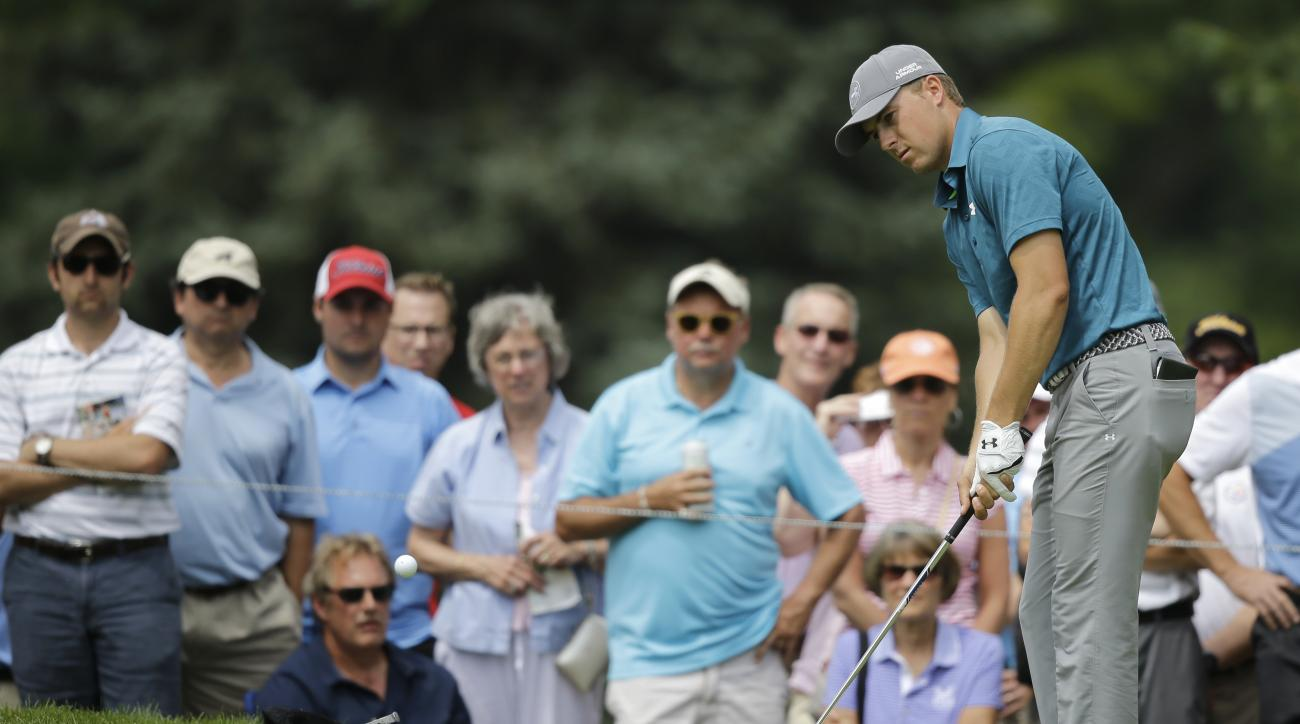 Jordan Spieth chips to the green on the eighth hole during the final round of the Bridgestone Invitational golf tournament at Firestone Country Club, Sunday, Aug. 9, 2015, in Akron, Ohio. (AP Photo/Tony Dejak)