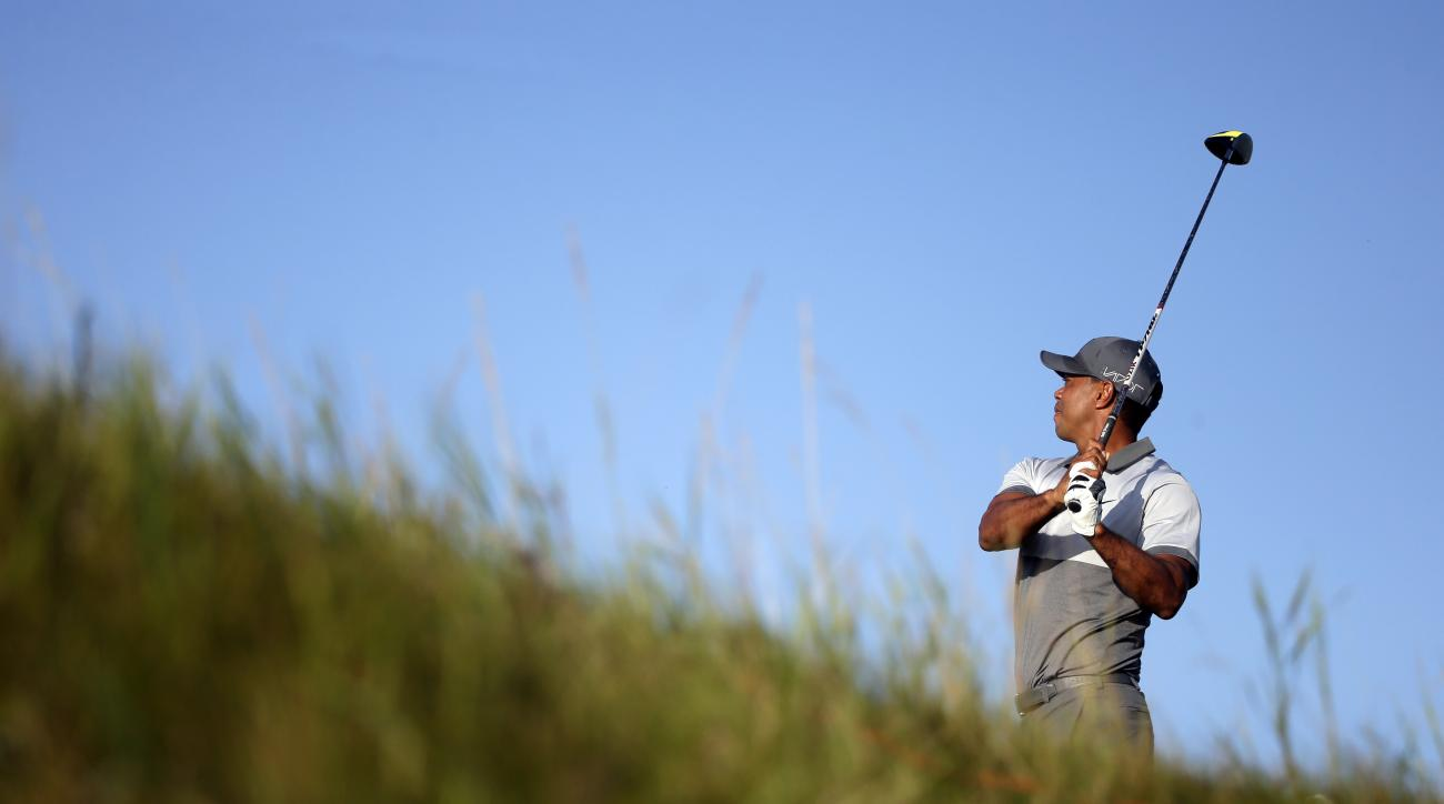 Tiger Woods watches his shot on the second hole during a practice round for the PGA Championship golf tournament Tuesday, Aug. 11, 2015, at Whistling Straits in Haven, Wis. (AP Photo/Jae Hong)