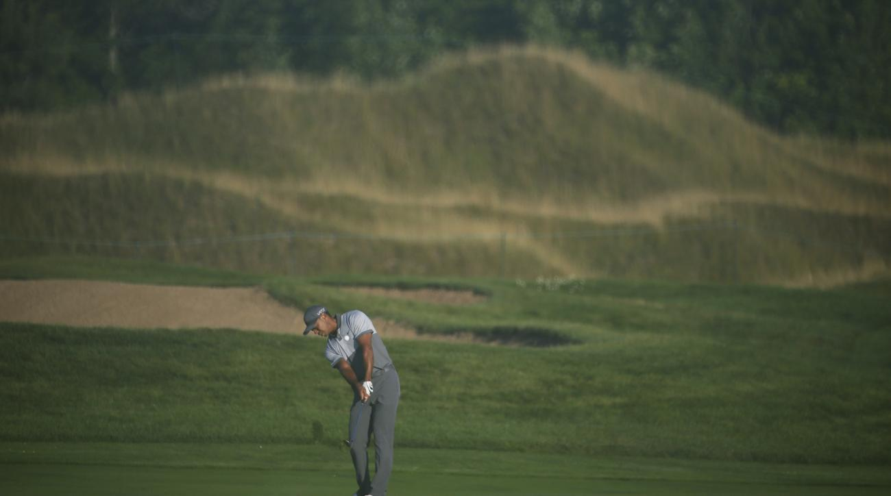 Tiger Woods hits a shot on the first hole during a practice round for the PGA Championship golf tournament Tuesday, Aug. 11, 2015, at Whistling Straits in Haven, Wis. (AP Photo/Chris Carlson)