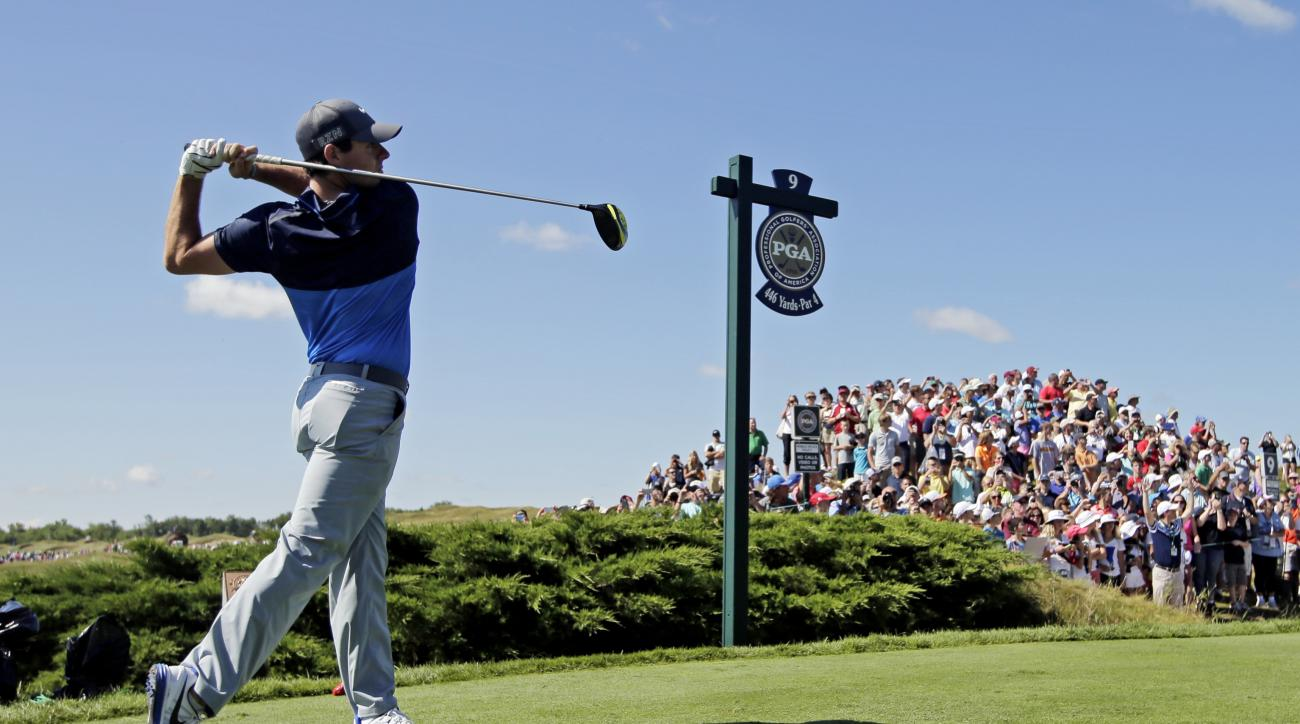 Rory McIlroy, of Northern Ireland, hits a drive on the ninth hole during a practice round for the PGA Championship golf tournament Tuesday, Aug. 11, 2015, at Whistling Straits in Haven, Wis. (AP Photo/Jae Hong)