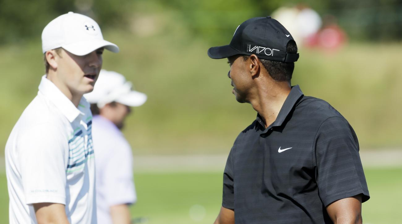 Jordan Spieth, left, talks to Tiger Woods during a practice round for the PGA Championship golf tournament Wednesday, Aug. 12, 2015, at Whistling Straits in Haven, Wis. (AP Photo/Chris Carlson)