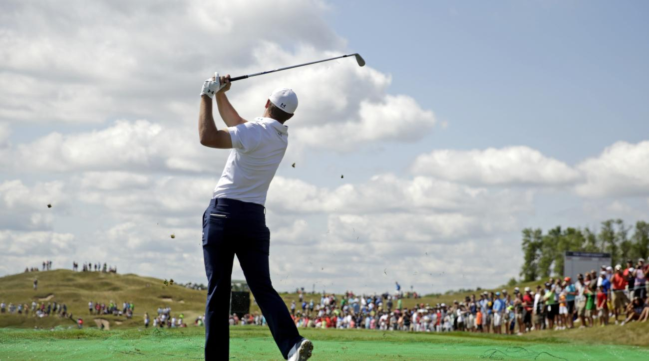 Jordan Spieth hits a shot on the third hole during a practice round for the PGA Championship golf tournament Wednesday, Aug. 12, 2015, at Whistling Straits in Haven, Wis. (AP Photo/Brynn Anderson)