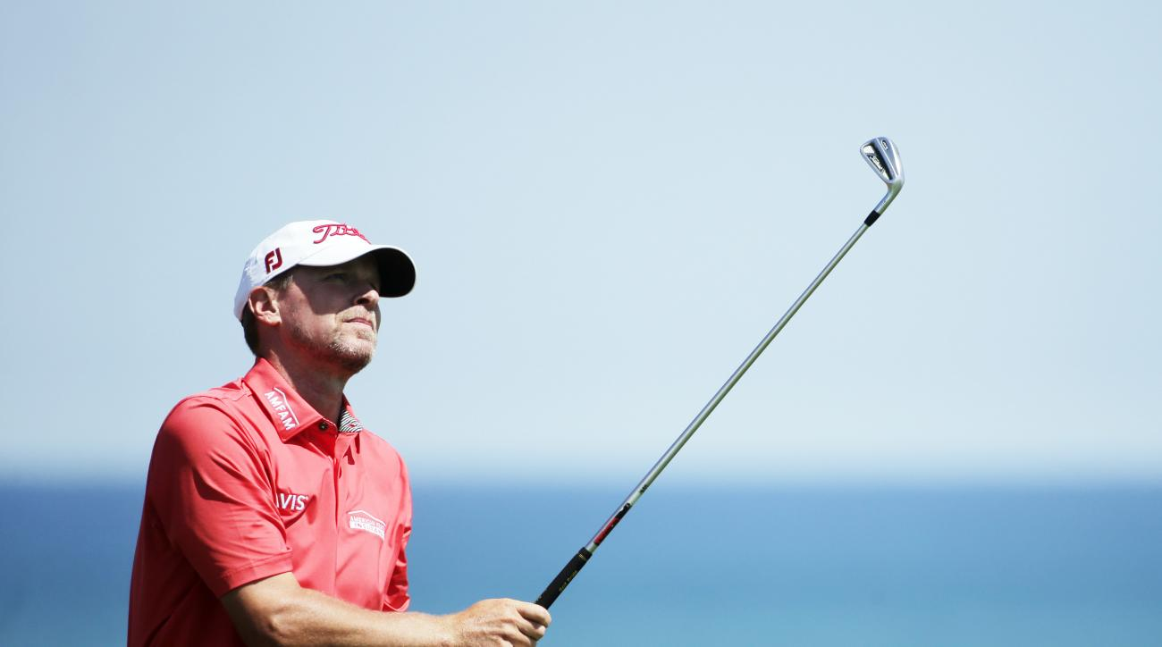 Steve Stricker watches his shot on the third hole during a practice round for the PGA Championship golf tournament Wednesday, Aug. 12, 2015, at Whistling Straits in Haven, Wis. (AP Photo/Jae Hong)