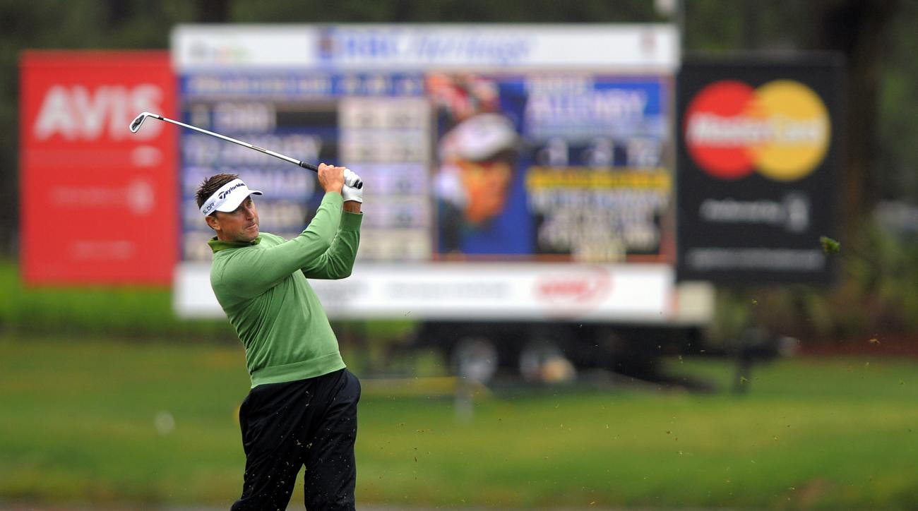FILE - In this April 19, 2014, file photo, Robert Allenby, of Australia, hits on the 10th fairway during the second round of the RBC Heritage golf tournament in Hilton Head Island, S.C. A Hawaii man has been sentenced Wednesday, Aug. 12, 2015, to five yea