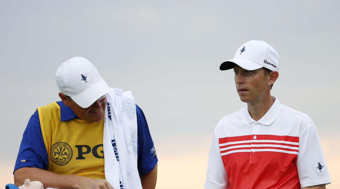 Brian Gaffney, right, looks at the 12th hole during the first round of the PGA Championship golf tournament Thursday, Aug. 13, 2015, at Whistling Straits in Haven, Wis. (AP Photo/Julio Cortez)
