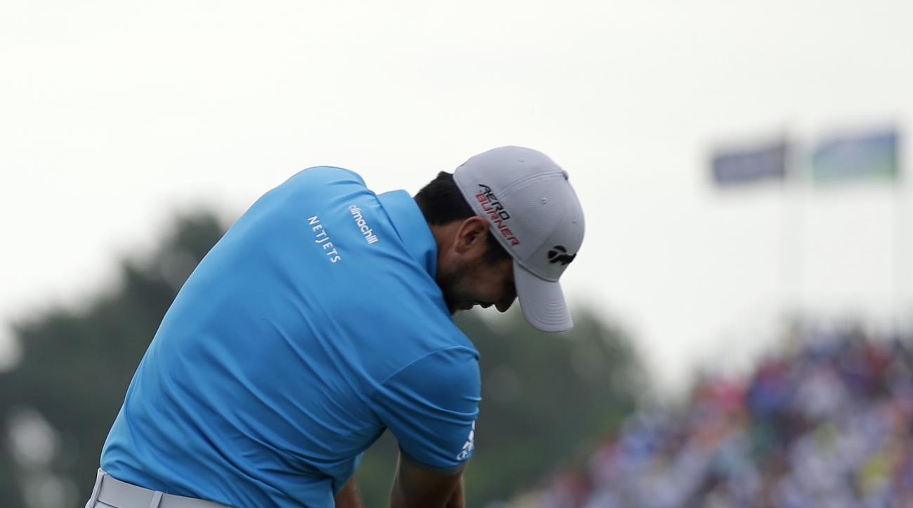 Jason Day, of Australia, hits a tee shot on the 17th hole during the first round of the PGA Championship golf tournament Thursday, Aug. 13, 2015, at Whistling Straits in Haven, Wis. (AP Photo/Jae Hong)