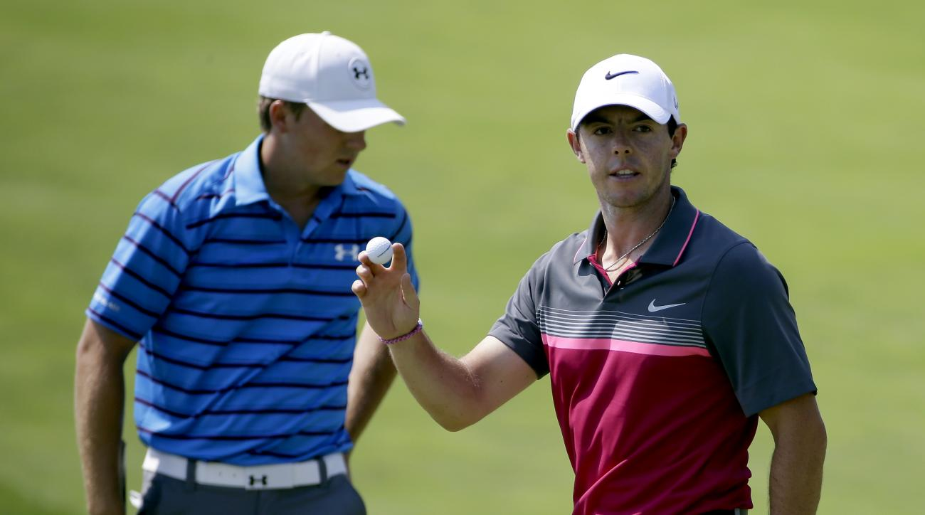 Rory McIlroy, of Northern Ireland, reacts in front of Jordan Spieth, left, after McIlloy made a birdie putt on the sixth hole during the second round of the PGA Championship golf tournament Friday, Aug. 14, 2015, at Whistling Straits in Haven, Wis. (AP Ph