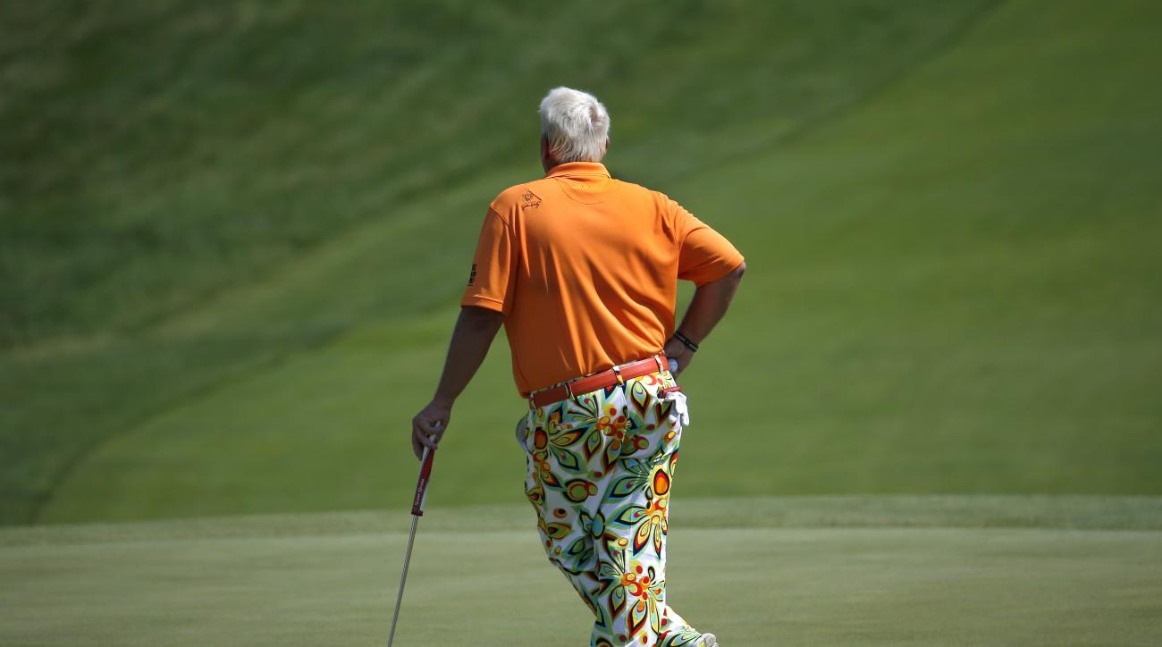 John Daly waits to hit on the ninth hole during the second round of the PGA Championship golf tournament Friday, Aug. 14, 2015, at Whistling Straits in Haven, Wis. (AP Photo/Julio Cortez)