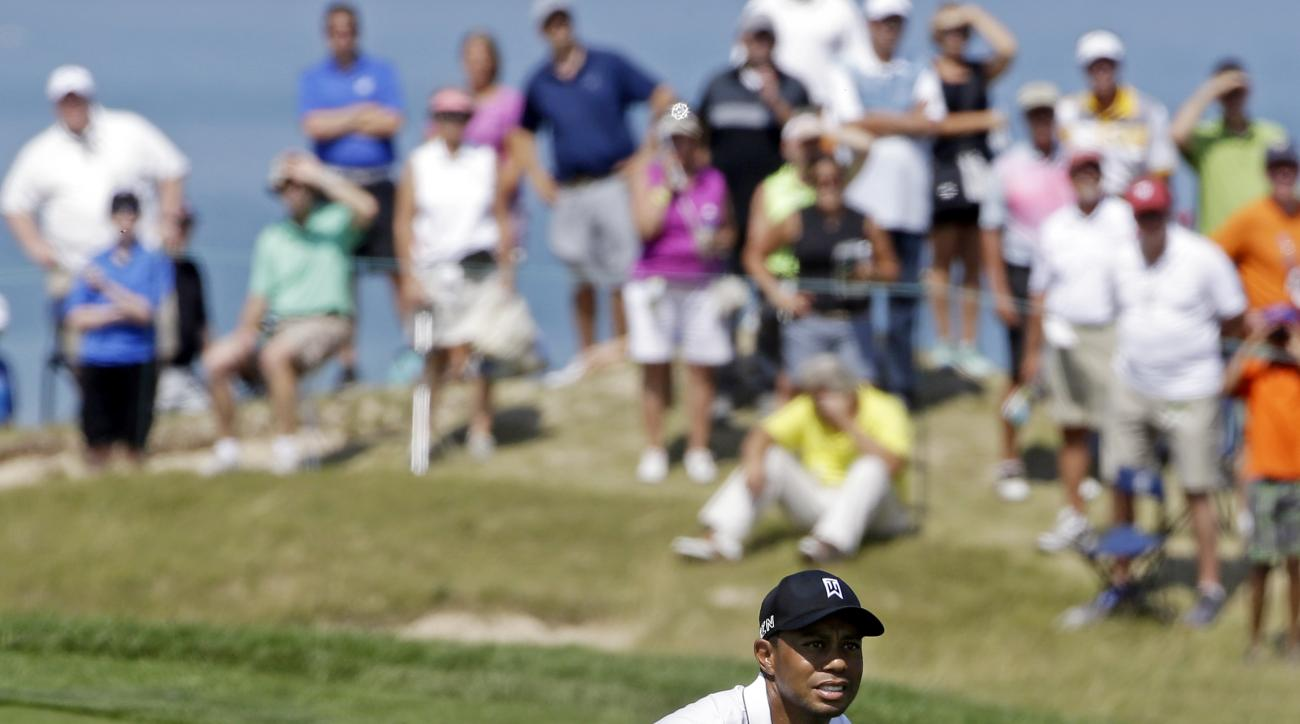 Tiger Woods watches his shot on the second hole during the second round of the PGA Championship golf tournament Friday, Aug. 14, 2015, at Whistling Straits in Haven, Wis. (AP Photo/Brynn Anderson)