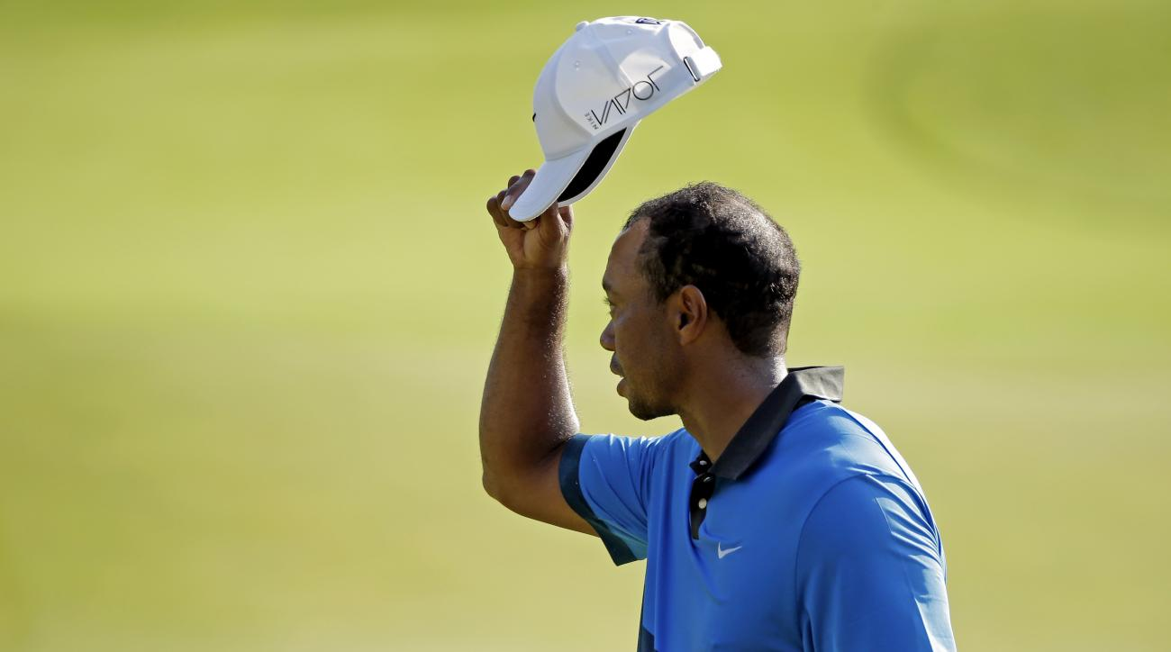 Tiger Woods tips his hat to the crowd on the 18th hole during the second round of the PGA Championship golf tournament Saturday, Aug. 15, 2015, at Whistling Straits in Haven, Wis. (AP Photo/Chris Carlson)