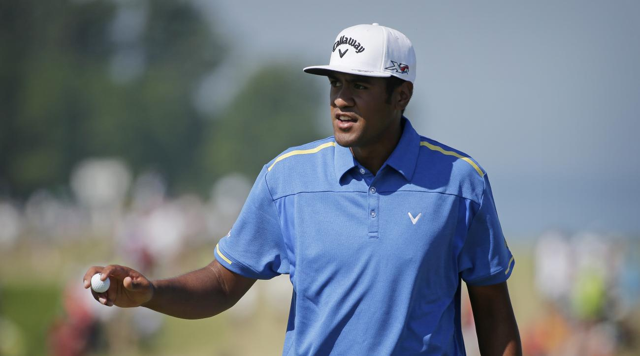Tony Finau reacts after making a birdie on the second hole during the third round of the PGA Championship golf tournament Saturday, Aug. 15, 2015, at Whistling Straits in Haven, Wis. (AP Photo/Jae Hong)