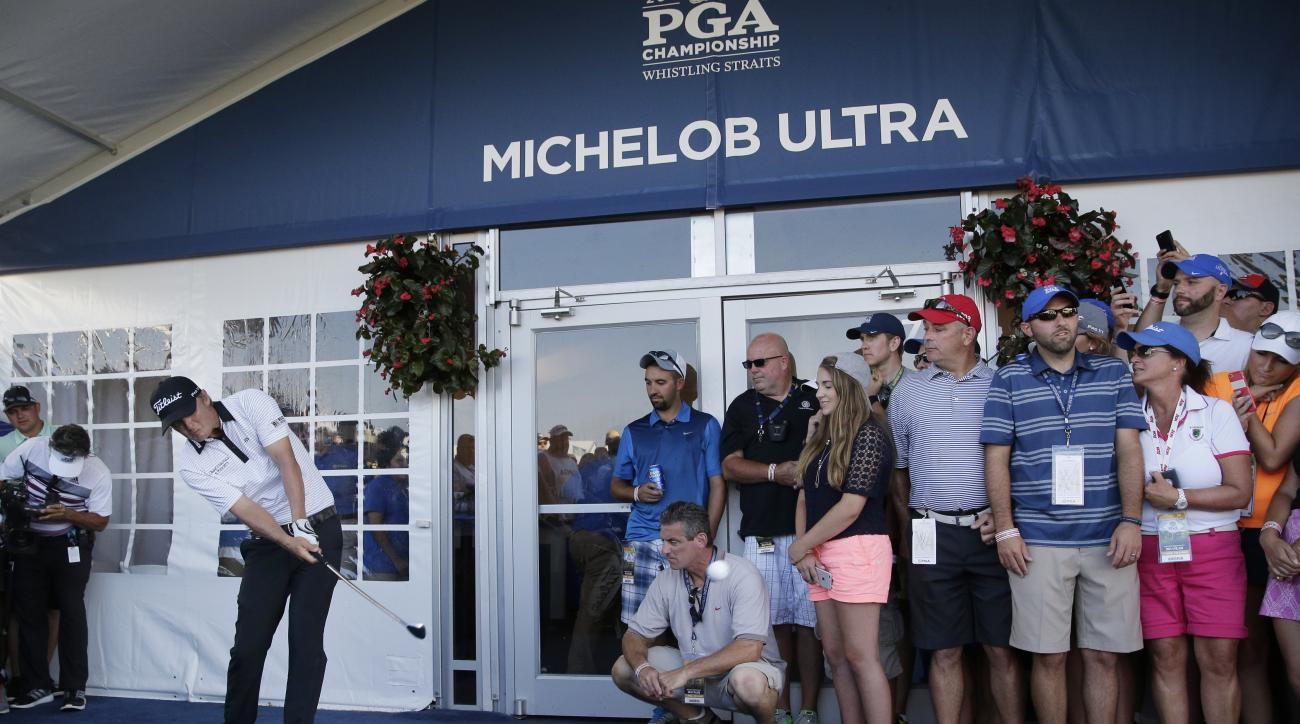 Matt Jones, of Australia, hits from a hospitality tent on the ninth hole during the third round of the PGA Championship golf tournament Saturday, Aug. 15, 2015, at Whistling Straits in Haven, Wis. (AP Photo/Jae Hong)