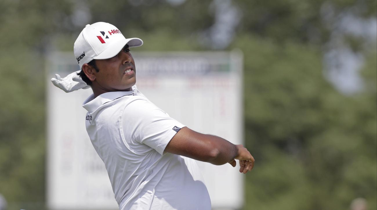 Anirban Lahiri, of India, drop his club after his drive on the second hole during the fourth round of the PGA Championship golf tournament Sunday, Aug. 16, 2015, at Whistling Straits in Haven, Wis. (AP Photo/Jae Hong)
