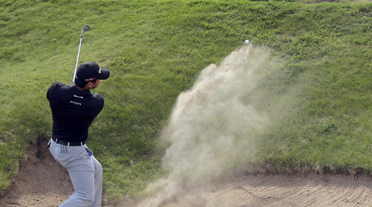 Jason Day, of Australia, hits from a bunker on the second hole during the fourth round of the PGA Championship golf tournament Sunday, Aug. 16, 2015, at Whistling Straits in Haven, Wis. (AP Photo/Jae Hong)