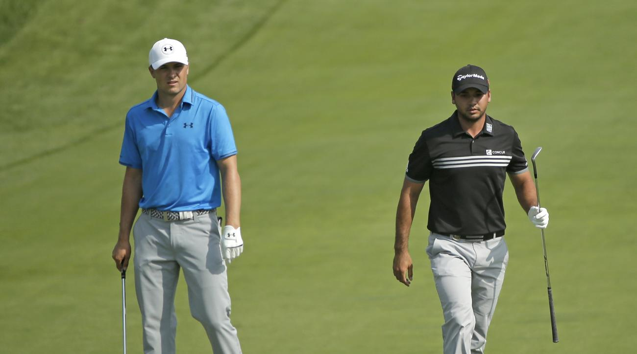 Jordan Spieth, left, and Jason Day, right, of Australia, walk to the ninth green during the fourth round of the PGA Championship golf tournament Sunday, Aug. 16, 2015, at Whistling Straits in Haven, Wis. (AP Photo/Chris Carlson)