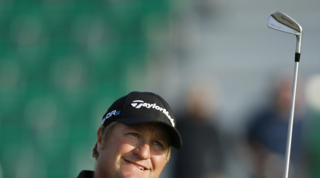 Dawie Van Der Walt of South Africa watches his shot off the 4th tee during the first day of the British Open Golf championship at the Royal Liverpool golf club, Hoylake, England, Thursday July 17, 2014. (AP Photo/Alastair Grant)