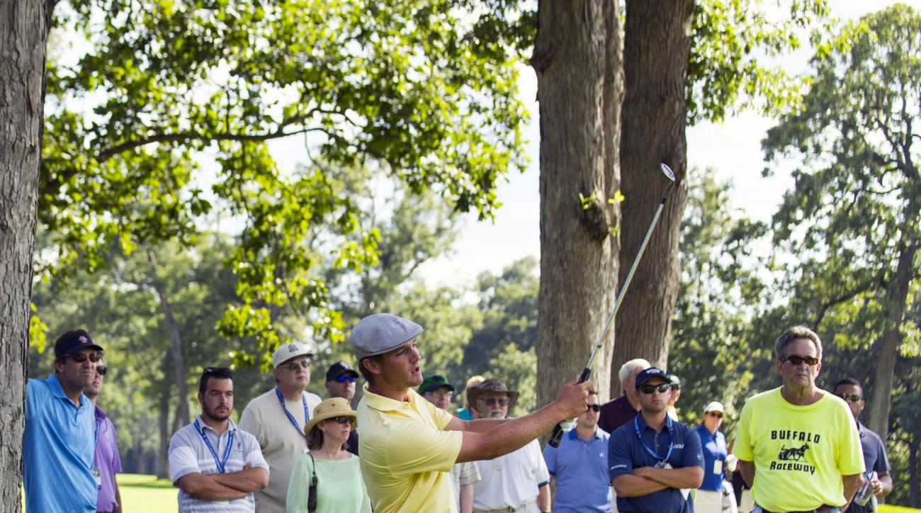 In this photo provided by the USGA, Bryson DeChambeau watches his pitch shot to the 14th hole during the quarterfinal round of match play of the 2015 U.S. Amateur at Olympia Fields Country Club in Olympia Fields, Ill. on Friday, Aug. 21, 2015. NCAA champi