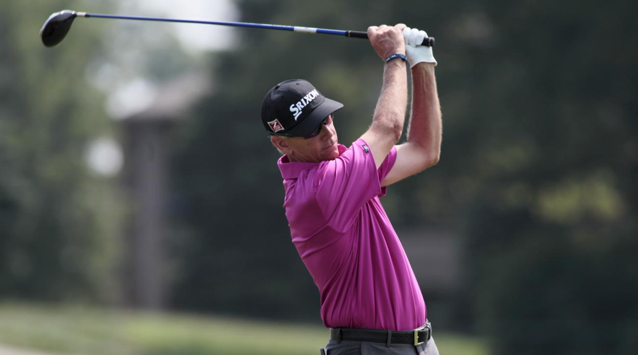 Larry Mize plays during the first round of the Champions Tour's 3M Championship golf tournament at TPC Twin Cities in Blaine, Minn., Friday, Aug. 1, 2014. (AP Photo/Paul Battaglia)