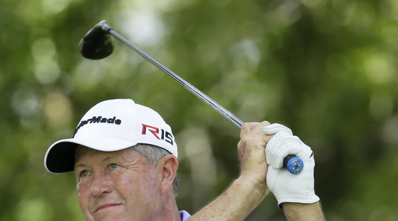 Rod Spittle watches his shot off the third tee during the final round of the Champions Tour's Principal Charity Classic golf tournament, Sunday, June 7, 2015, in Des Moines, Iowa. (AP Photo/Charlie Neibergall)