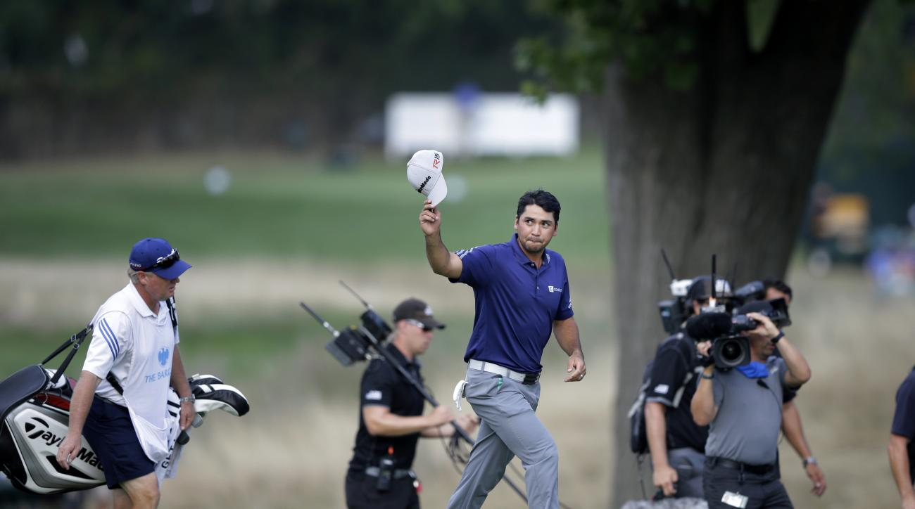 Jason Day, of Australia, waves his cap as he walks onto the green on the 18th green on the way to winning The Barclays golf tournament Sunday, Aug. 30, 2015, in Edison, N.J. (AP Photo/Mel Evans)
