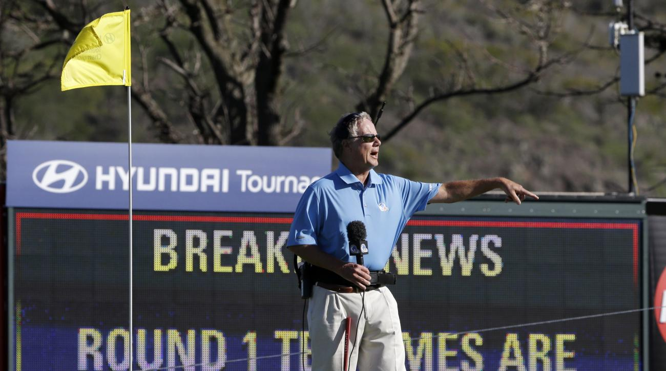 FILE - In this Jan. 6, 2013, file photo, broadcast analyst Mark Rolfing talks about the wind from the 10th green before the first round of a golf tournament in Kapalua, Hawaii. Play was to have started two days earlier, but was delayed because of rain and