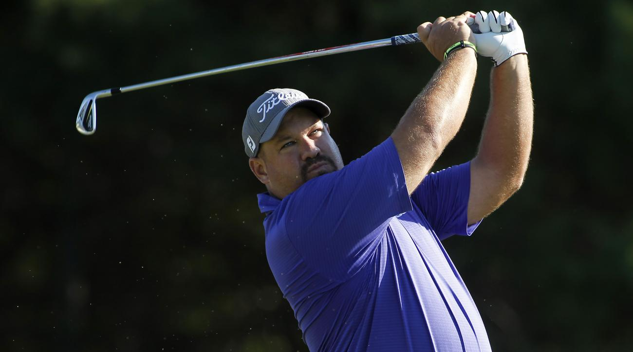 Brendon de Jonge, from Zimbabwe, tees off on the third hole during the second round of the Deutsche Bank Championship golf tournament in Norton, Mass., Saturday, Sept. 5, 2015. (AP Photo/Stew Milne)