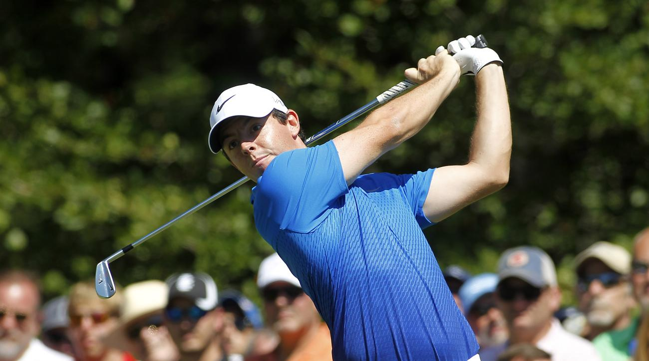 Rory McIlroy, from Northern Ireland, hits his tee shot on the first hole during the second round of the Deutsche Bank Championship golf tournament in Norton, Mass., Saturday, Sept. 5, 2015. (AP Photo/Stew Milne)