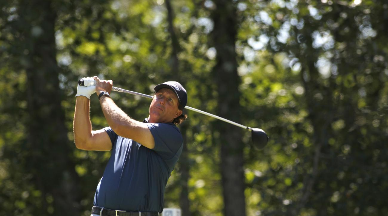 Phil Mickelson hits his tee shot on the second hole during the second round of the Deutsche Bank Championship golf tournament in Norton, Mass., Saturday, Sept. 5, 2015. (AP Photo/Stew Milne)