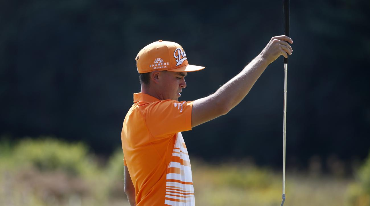 Rickie Fowler lines up a putt on the second hole during the final round of the Deutsche Bank Championship golf tournament in Norton, Mass., Monday, Sept. 7, 2015. (AP Photo/Michael Dwyer)