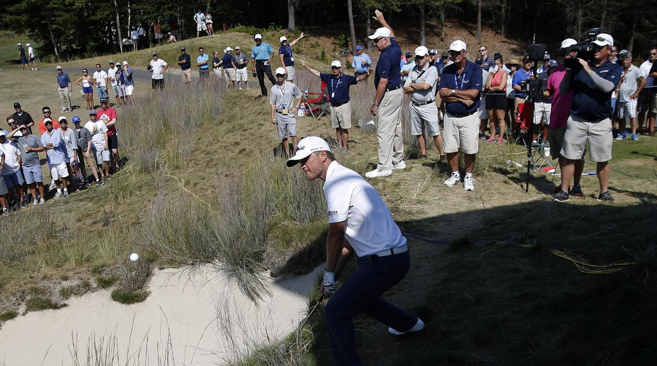 Matt Jones, of Australia, chips from the rough onto the second green during the final round of the Deutsche Bank Championship golf tournament in Norton, Mass., Monday, Sept. 7, 2015. (AP Photo/Michael Dwyer)