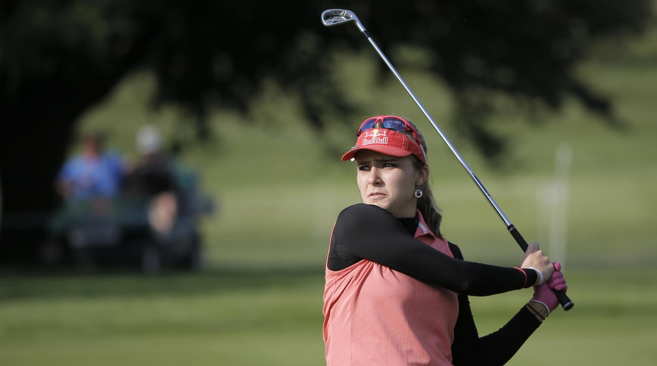 Lexi Thompson, of USA, follows her ball after playing on the 15th hole during the first round of the Evian Championship women's golf tournament in Evian, eastern France, Thursday, Sept. 10, 2015. (AP Photo/Laurent Cipriani)