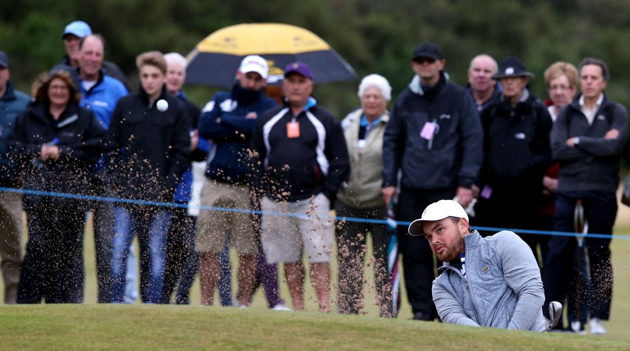 Hunter Stewart of the US plays out of the bunker on the 11th hole during day one of the Walker Cup at Royal Lytham & St Annes golf club, Lytham St Annes, England, Saturday Sept. 12, 2015. (Peter Byrne/PA via AP) UNITED KINGDOM OUT  NO SALES  NO ARCHIVE