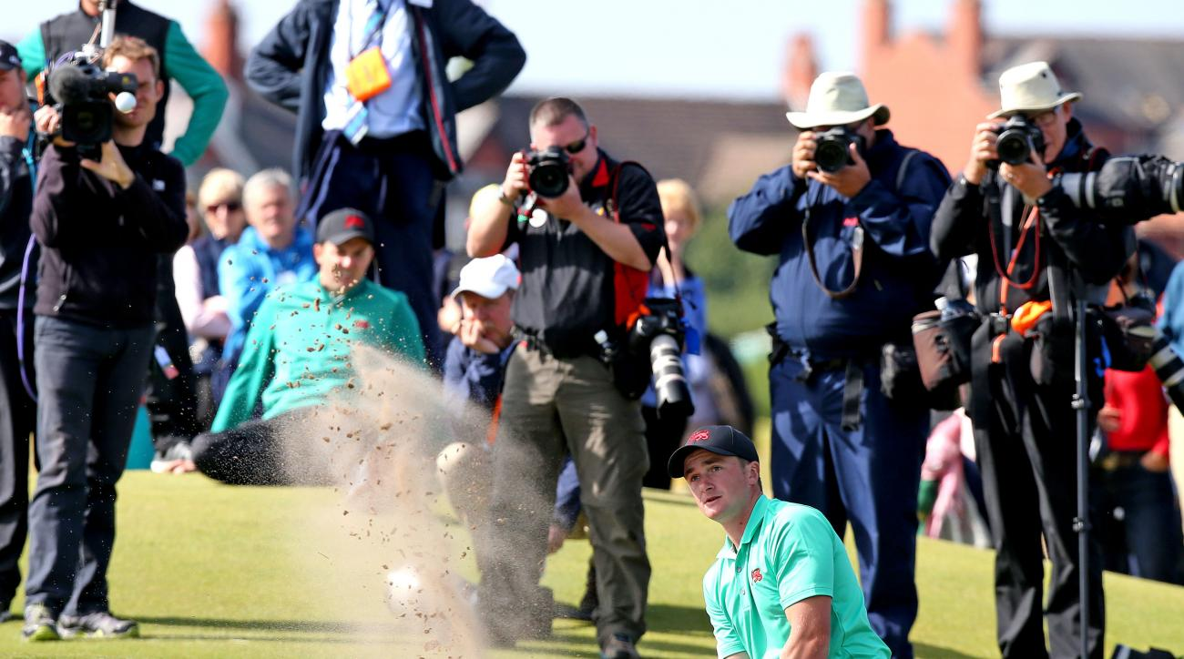 Great Britain and Ireland's Paul Dunne chips out of the bunker on the 16th hole during day two of the Walker Cup at Royal Lytham & St Annes Golf Club, Lytham St Annes, England, Sunday Sept. 13, 2015. (Peter Byrne/PA via AP) UNITED KINGDOM OUT  NO SALES  N