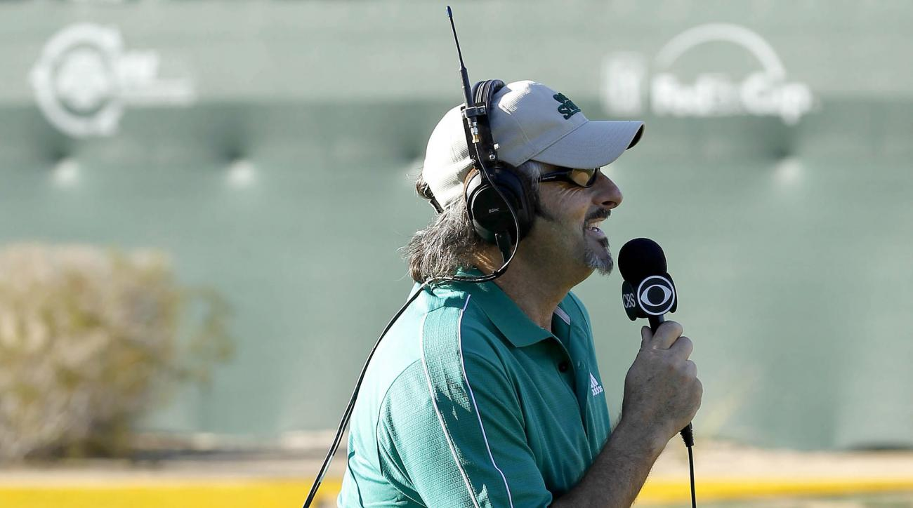 FILE - In this Feb. 4, 2012, file photo, golf announcer David Feherty broadcasts from the 16th green during the third round of the Phoenix Open golf tournament in Scottsdale, Ariz. Feherty has signed a contract with NBC Sports that will put him on the bro