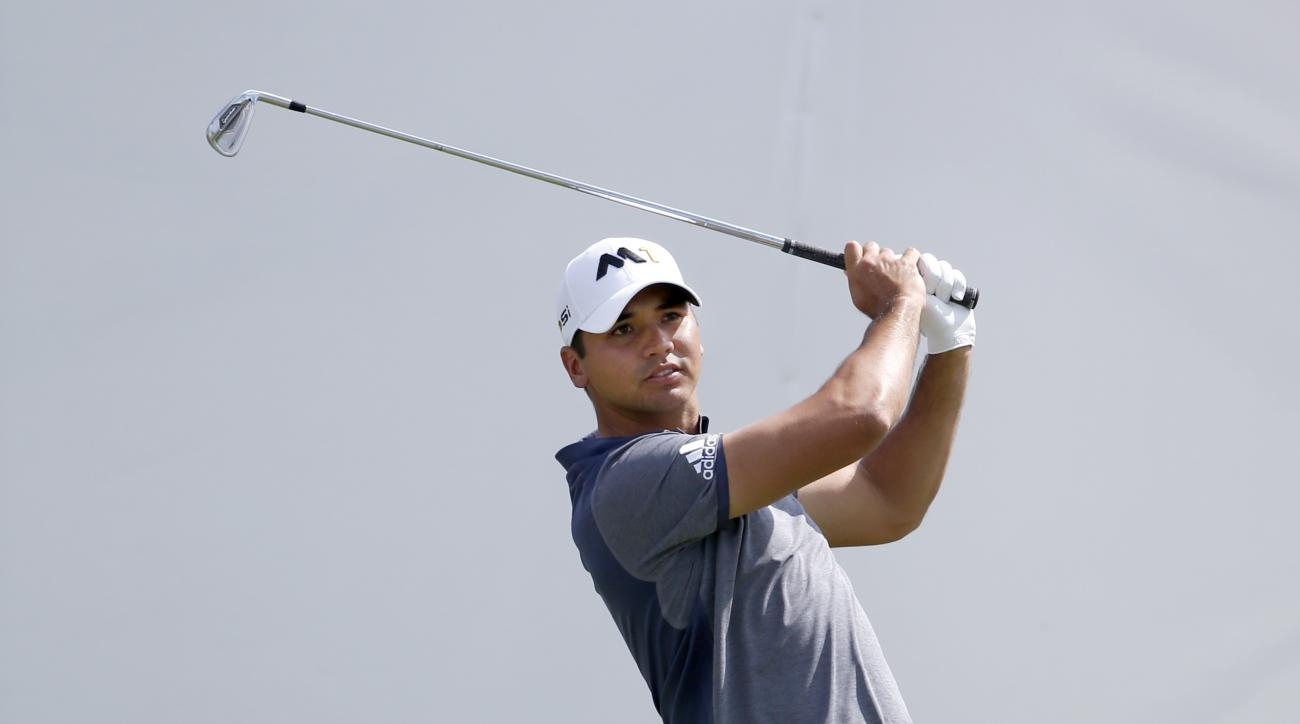 Jason Day of Australia, watches his tee shot on the first hole during the final round of the BMW Championship golf tournament at Conway Farms Golf Club, Sunday, Sept. 20, 2015, in Lake Forest, Ill. (AP Photo/Charles Rex Arbogast)