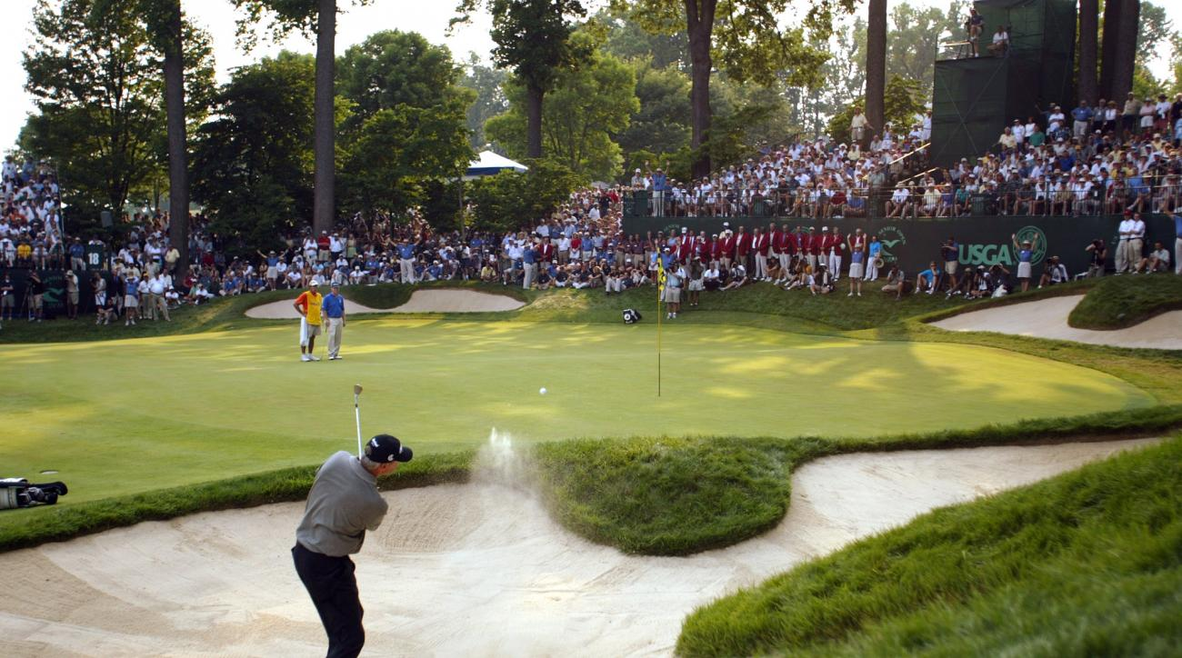 Don Pooley hits out of a sand trap on the 18th green of the last hole of regulation at the U.S. Senior Open at Caves Valley Golf Club in Owings Mills, Md., Sunday, June 30, 2002. Pooley parred the hole, setting up a playoff with Tom Watson, in blue shirt