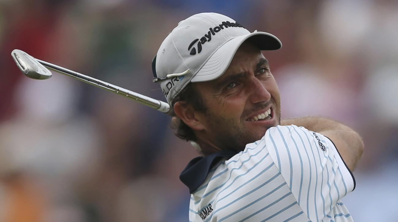FILE - This is a Sunday July 20, 2014 file photo of Edoardo Molinari of Italy as he plays a shot from the 4th tee during the final round of the British Open Golf championship at the Royal Liverpool golf club, Hoylake, England. Former Ryder Cup player Edoa