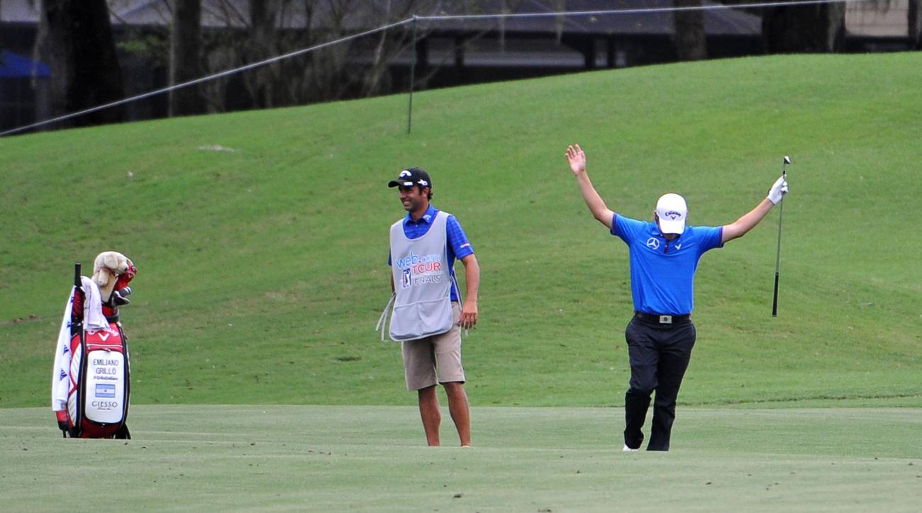 Emiliano Grillo reacts after hitting his second shot from the 18th fairway as his caddie watches during the second round of the Web.Com Tour Championship, Friday, Oct. 2, 2015 in Ponte Vedra Beach, Fla. (Bob Mack/The Florida Times-Union via AP) MANDATORY