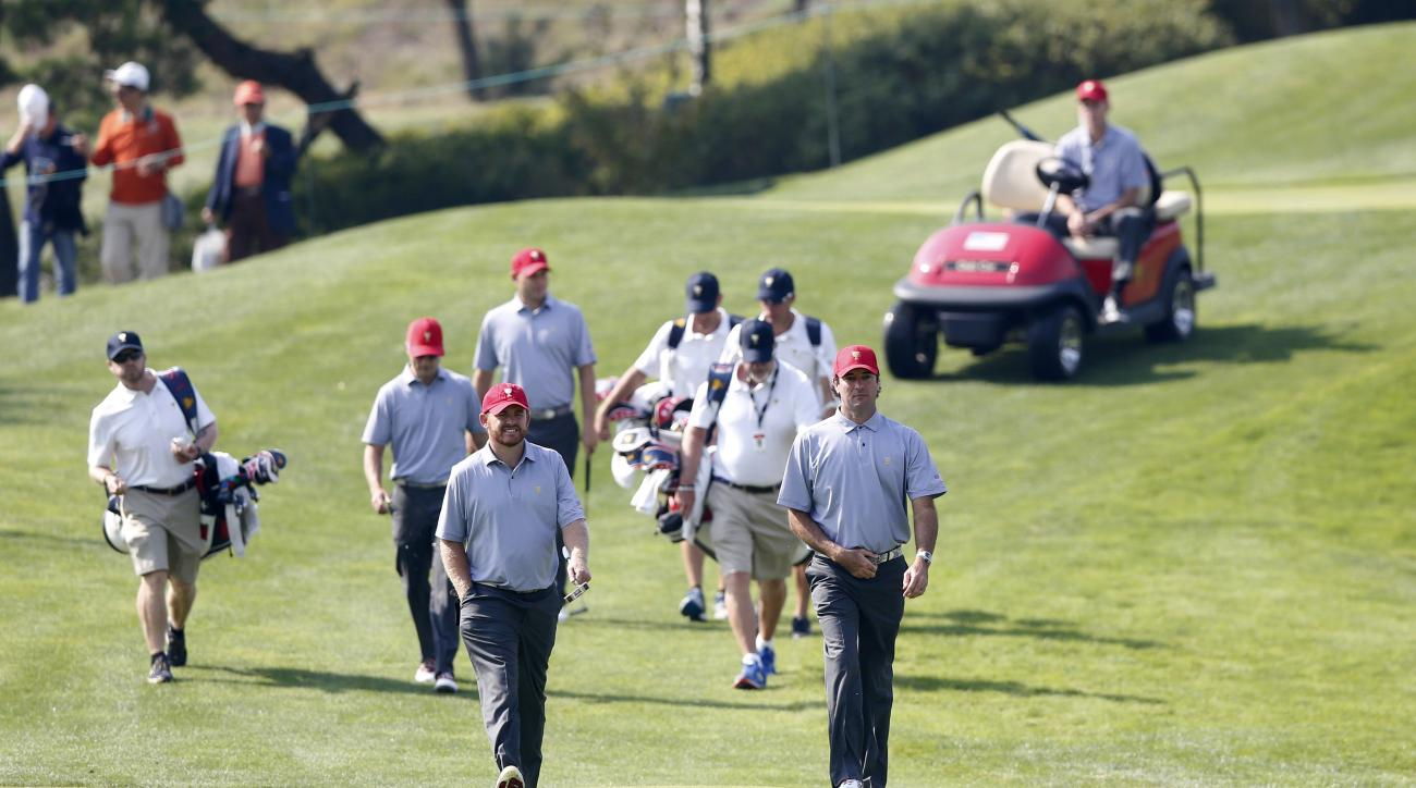 United States team players Bubba Watson, right, and J.B. Holmes walk on the fifth hole during a practice round ahead of the Presidents Cup golf tournament at Jack Nicklaus Golf Club Korea in Incheon, South Korea, Tuesday, Oct. 6, 2015. (AP Photo/Lee Jin-m